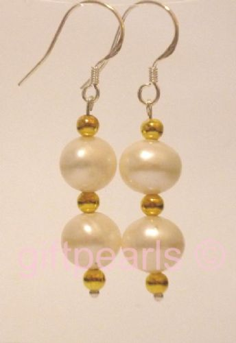 Double white pearl with golden beads.